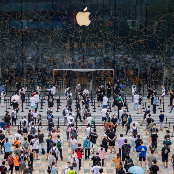 People line up to get inside the newly-opened Apple Store at Sanlitun in Beijing, China on July 17, 2020.