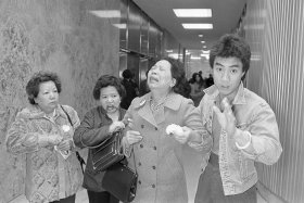 Lillie Chin, mother of Vincent chin who was clubbed to death by two white men in June 1982, breaks down as a relative (L), helps her walk while leaving Detroit's City County Building. Mrs. Chin along with the American Citizens for Justice are asking Judge Charles Kaufman, who heard the case and passed sentence, to resentence the two involved in the slayings. Kaufman sentenced the men to 3 years probation after plea bargaining agreements.