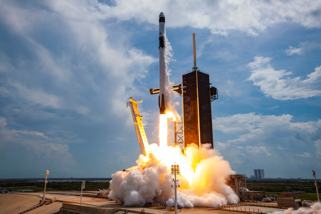 In this SpaceX handout image, a Falcon 9 rocket carrying the company's Crew Dragon spacecraft launches on the Demo-2 mission to the International Space Station with NASA astronauts Robert Behnken and Douglas Hurley onboard at Launch Complex 39A May 30, 2020, at the Kennedy Space Center, Florida.
