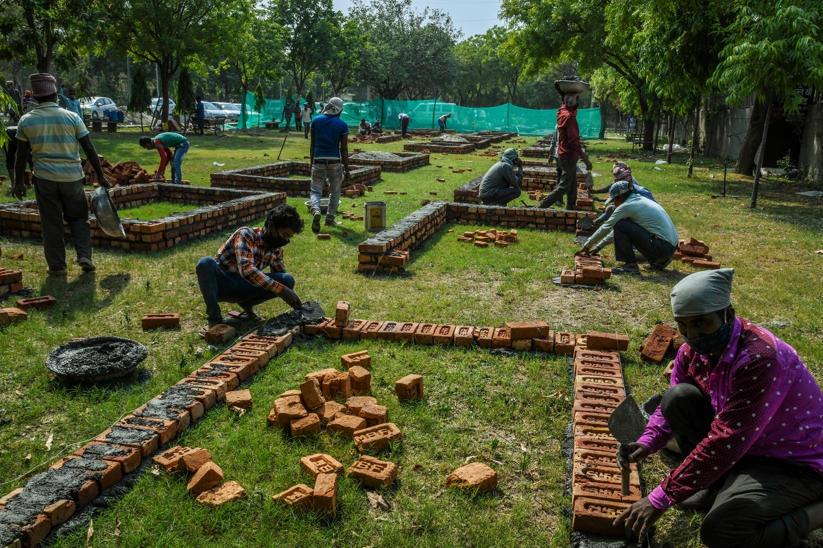 Workers build new platforms to expand a mass cremation site in New Delhi on April 27.