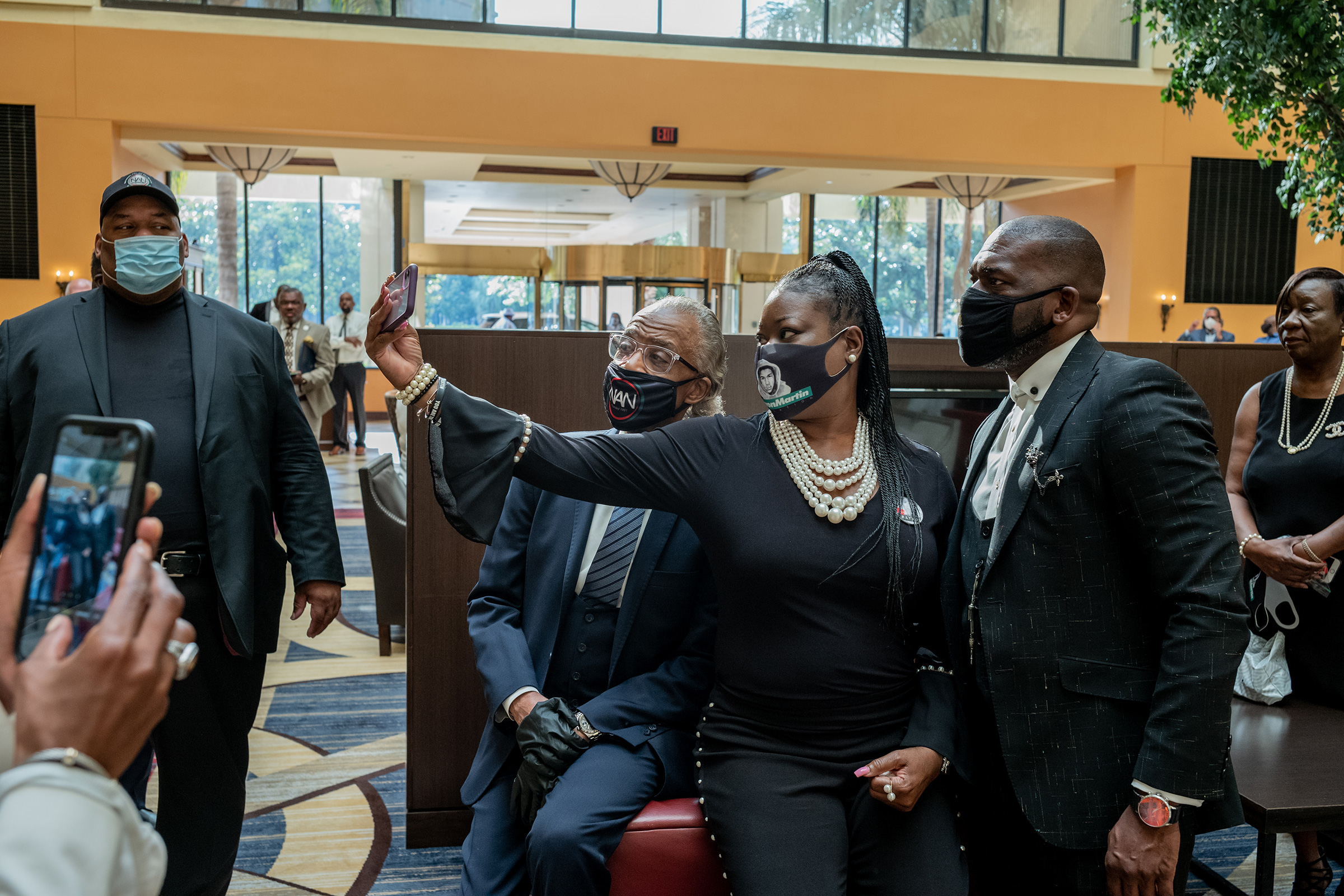 Rev. Al Sharpton takes a photograph with Sybrina Fulton and Pastor Jamal H Bryant before George Floyd's funeral on June 9, 2020.