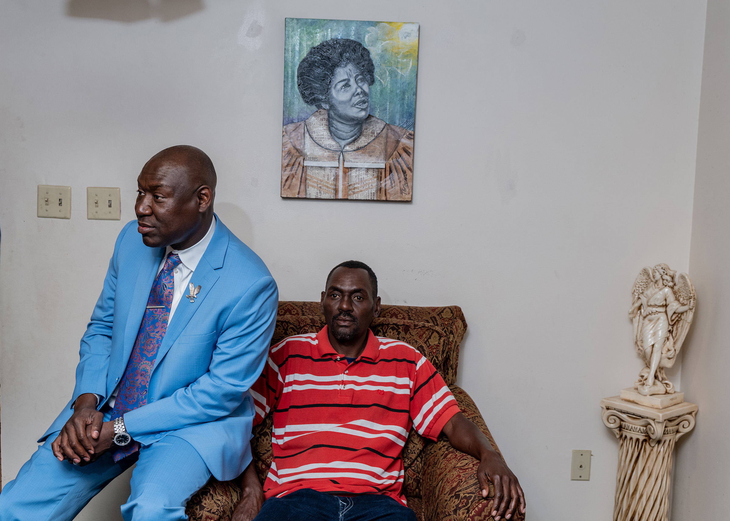 Crump sits with his Uncle Harold at his Mother's home in Tallahassee, Fla., on April 4.