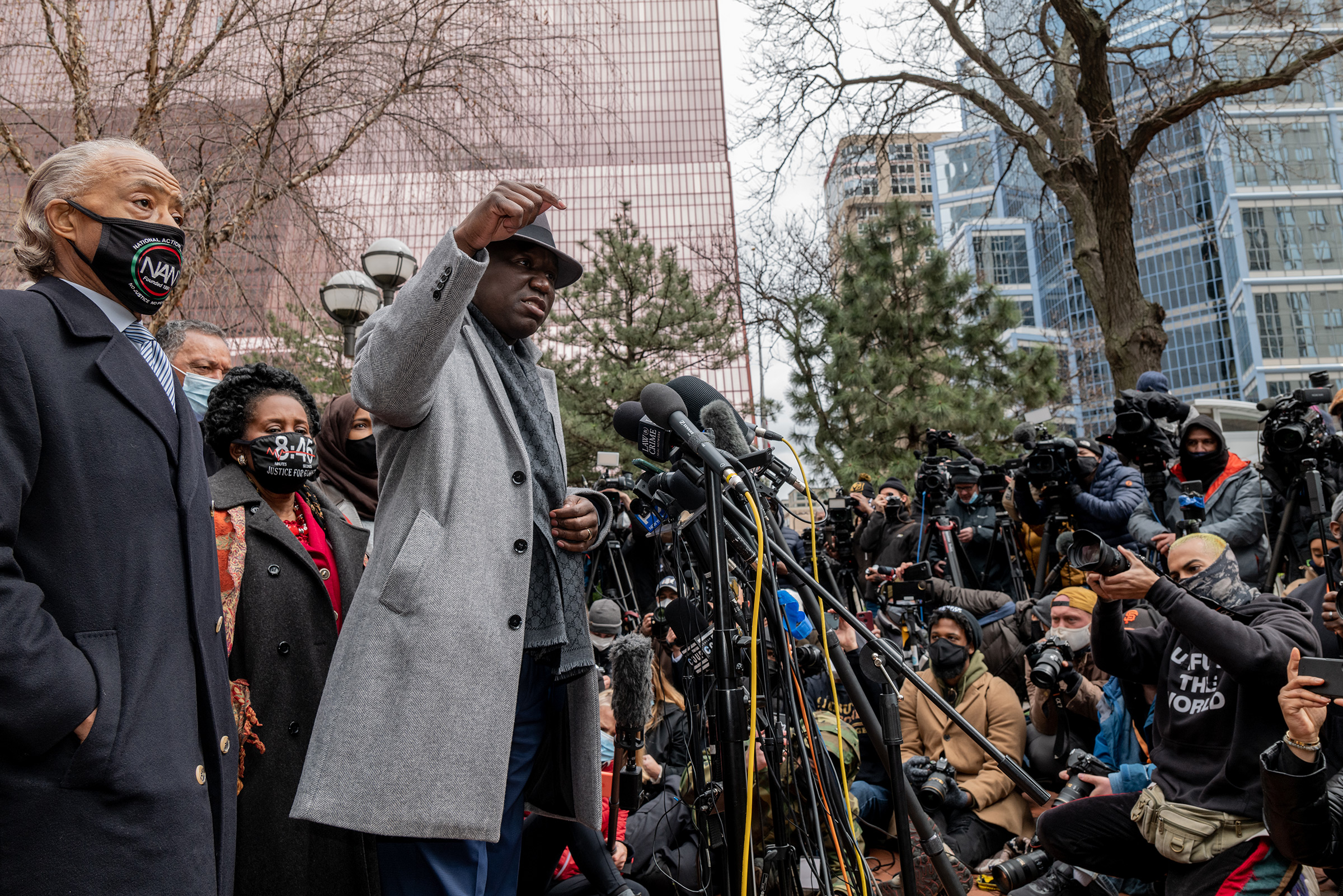Attorney Ben Crump speaks before the Rev. Al Sharpton and leads a prayer outside of the courthouse during closing arguments in the Chauvin trial in Minneapolis on April 19.