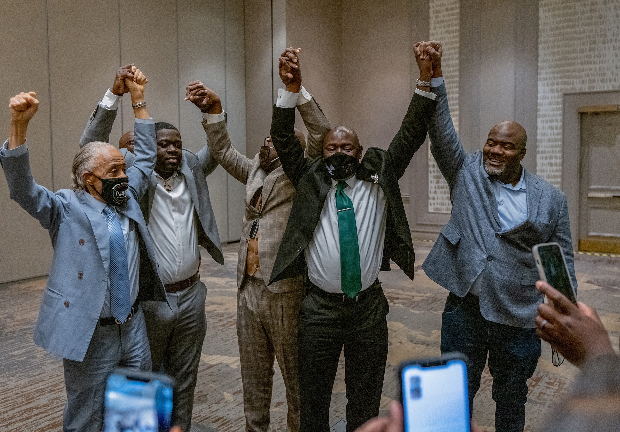 Attorney Ben Crump (C), with Reverend Al Sharpton (L) and members of George Floyd's family, reacts following the guilty verdict in the trial of former police officer Derek Chauvin in Minneapolis on April 20.