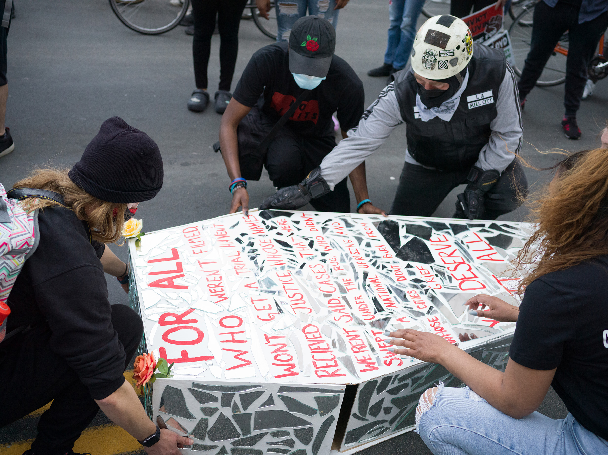 Protesters lift a a makeshift coffin, paying homage to all the slain victims of police killing who were not filmed, outside the Derek Chauvin trial in Minneapolis on March 29.