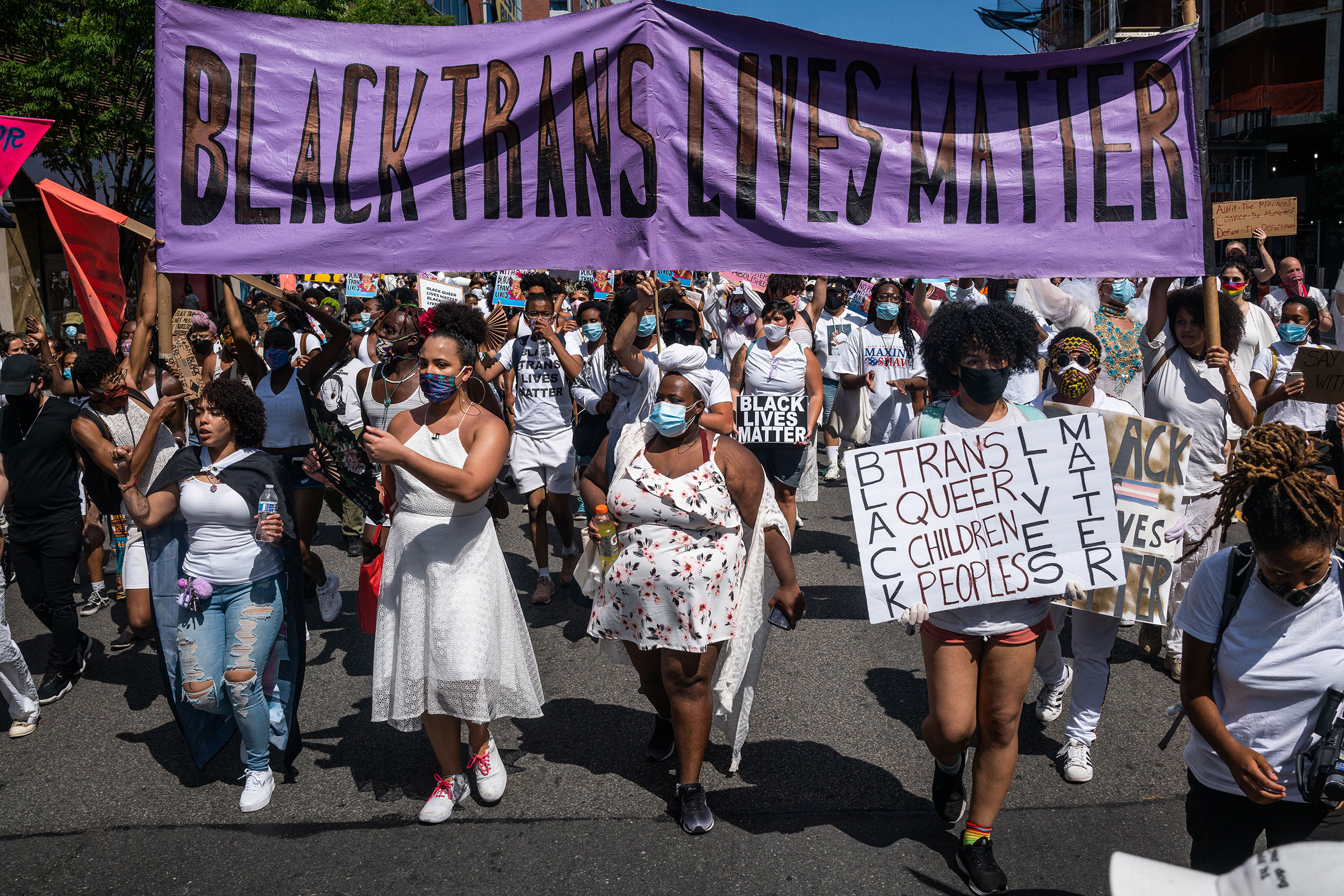 Demonstrators carry a banner reading  Black Trans Lives Matter  during a march in New York, on June 14, 2020.