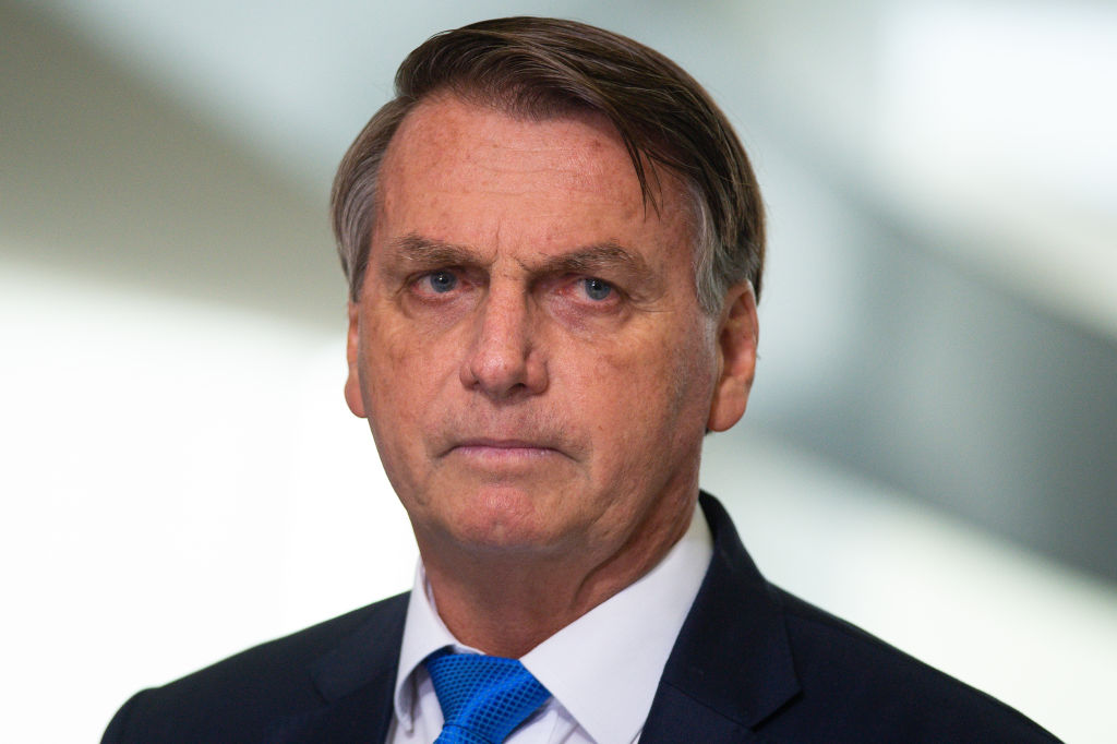 Jair Bolsonaro, Brazil's president, pauses while speaking during a news conference at the Planalto Palace in Brasilia, Brazil, on Wednesday, March 31, 2021. Commanders of Brazil's army, navy and air force were fired on Tuesday after Bolsonaro dismissed his defense chief as part of a broader cabinet restructuring.