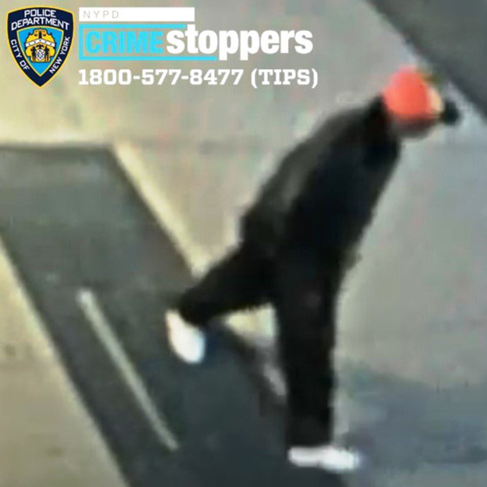 This Friday, April 23, 2021 image from surveillance video made available by the New York City Police Department shows an unidentified individual police who are seeking after a 61-year-old Asian man was attacked in the East Harlem neighborhood of New York.