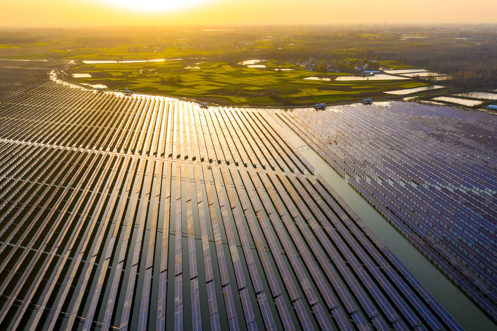 Aerial view of solar panels installed atop a reservoir at a fishery-solar hybrid photovoltaic power station on March 25, 2021 in Anhui, Hefei Province of China.