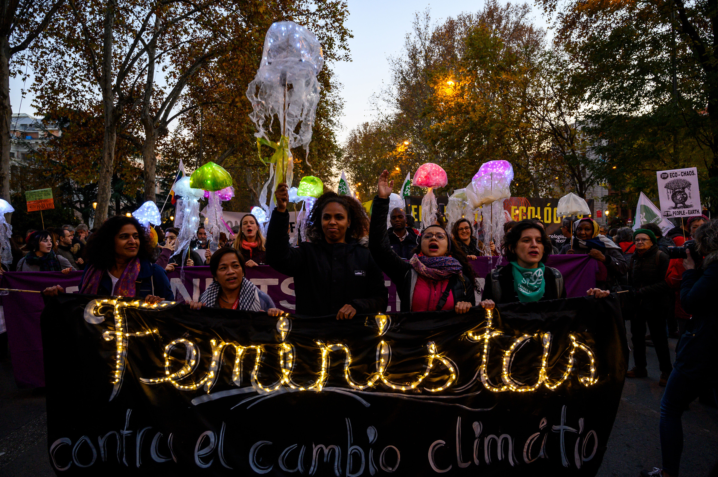 "Women hold a banner that reads ""Feminists against climate change"" at a 2019 protest in Madrid."
