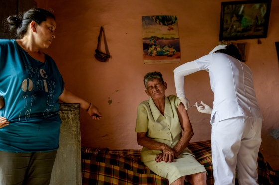 Saturia Campos, 80, receives a dose of the Novavax vaccine as her daughter watches in Chaguaní, Colombia, on April 8, 2021. Vaccination brigades made their way into inhospitable rural areas to administer COVID-19 vaccines to senior citizens. Depending on the distances and difficulty of access, each brigade vaccinates between 12 and 18 people per day.