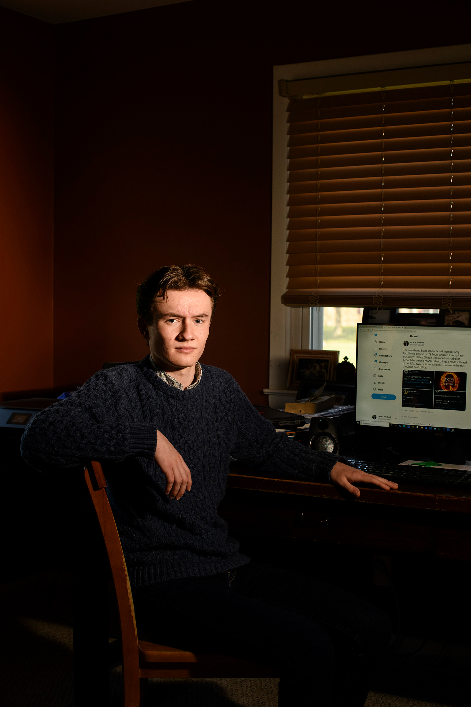 Lucas Hartwell, a senior at Grand Blanc Community High School, in the room he uses as his work space in Grand Blanc, Mich.
