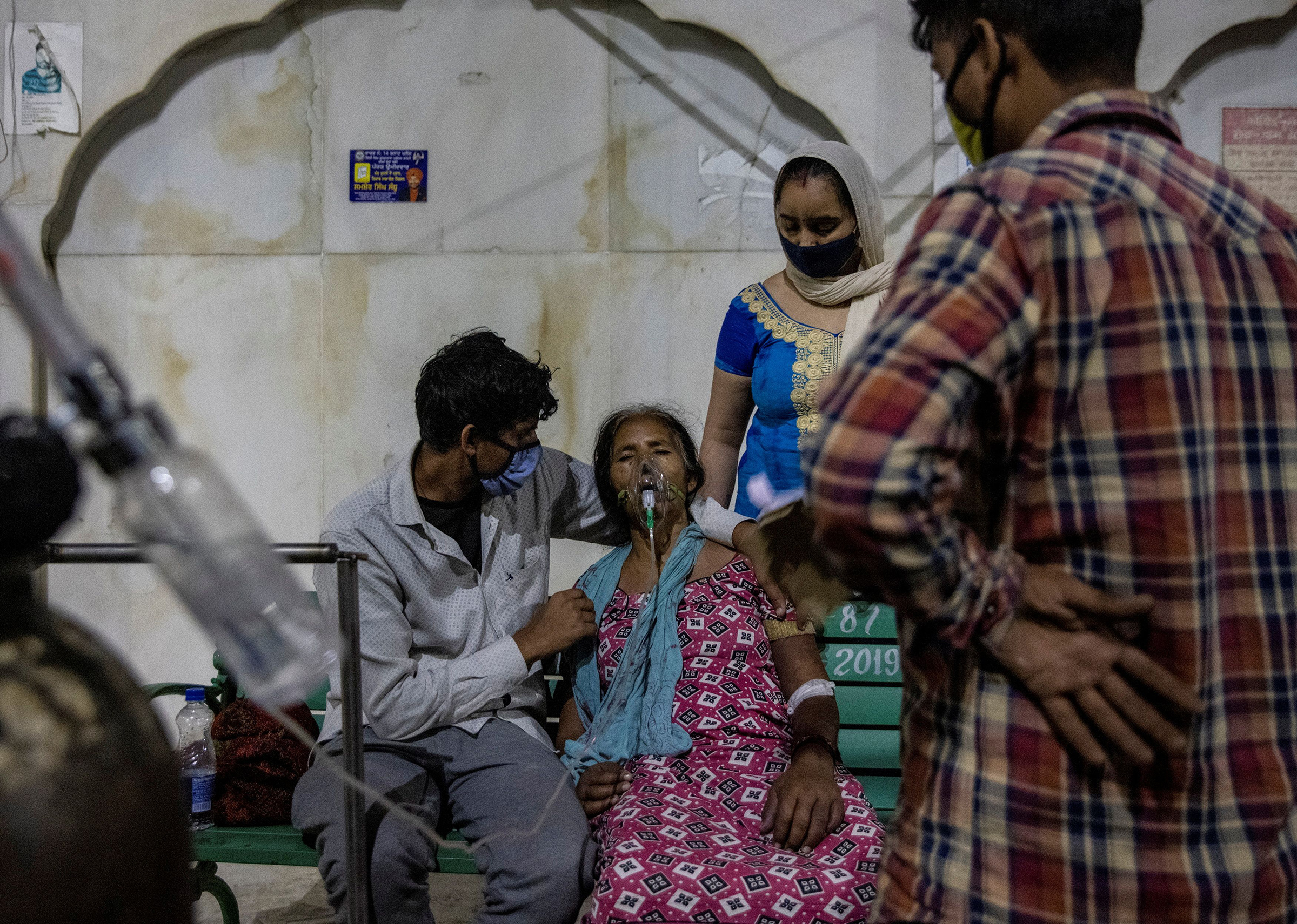A woman receives free oxygen support at a Sikh temple in Ghaziabad, India, on April 24, 2021.