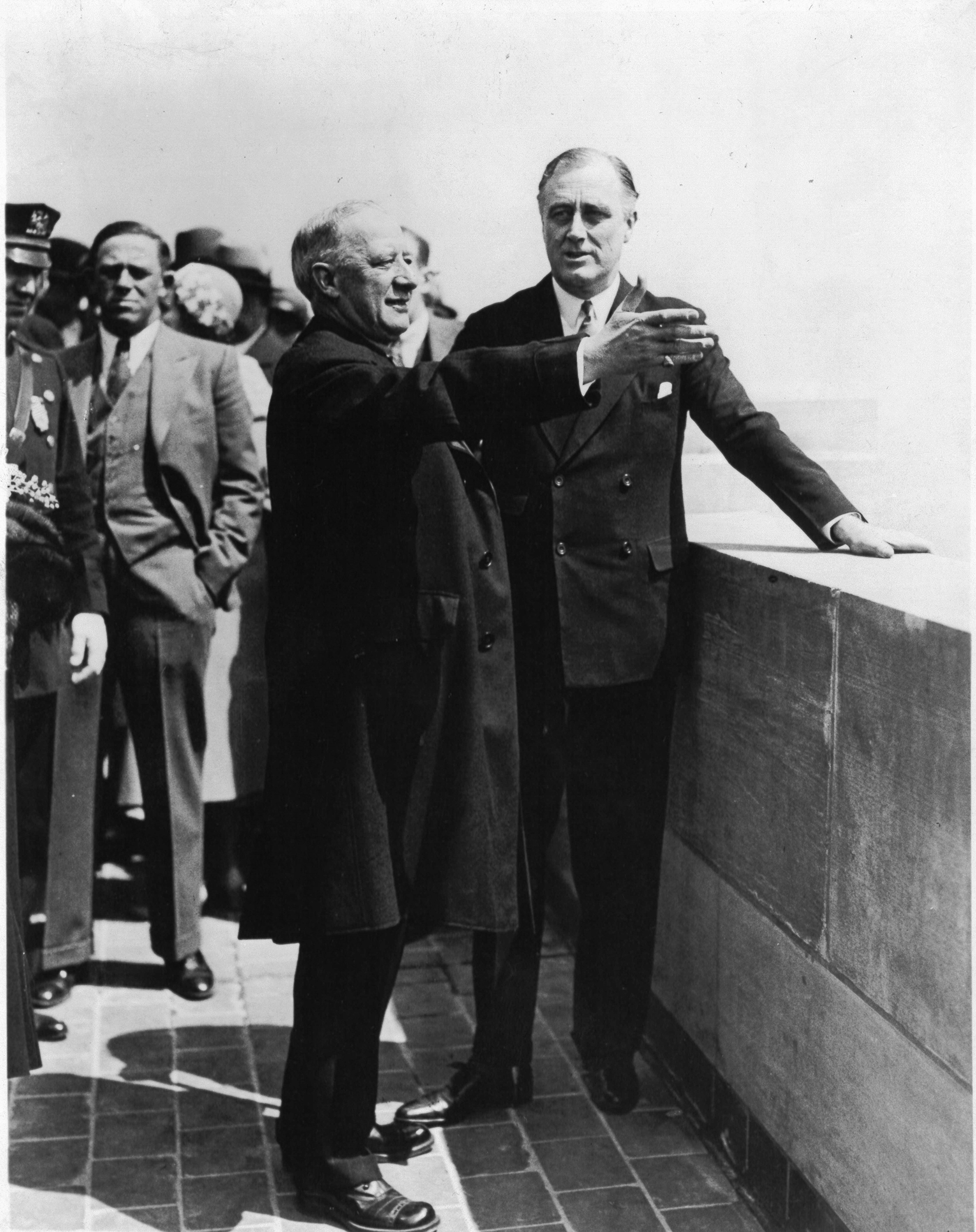 Former Governor Alfred E. Smith points out the sights of the city to Governor Roosevelt from an Empire State Building observation floor on May 1, 1931.