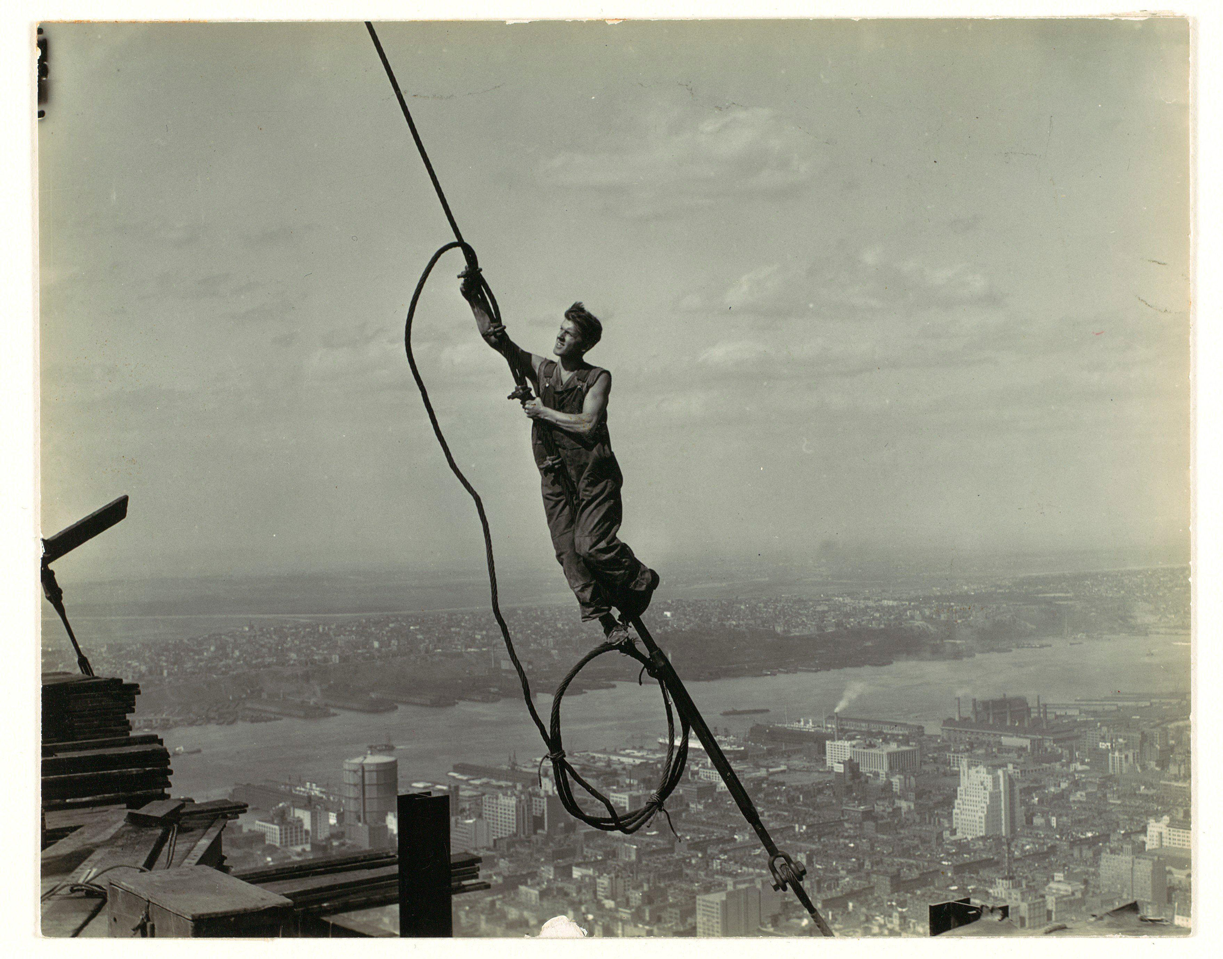 High up on the Empire State Building, 1930