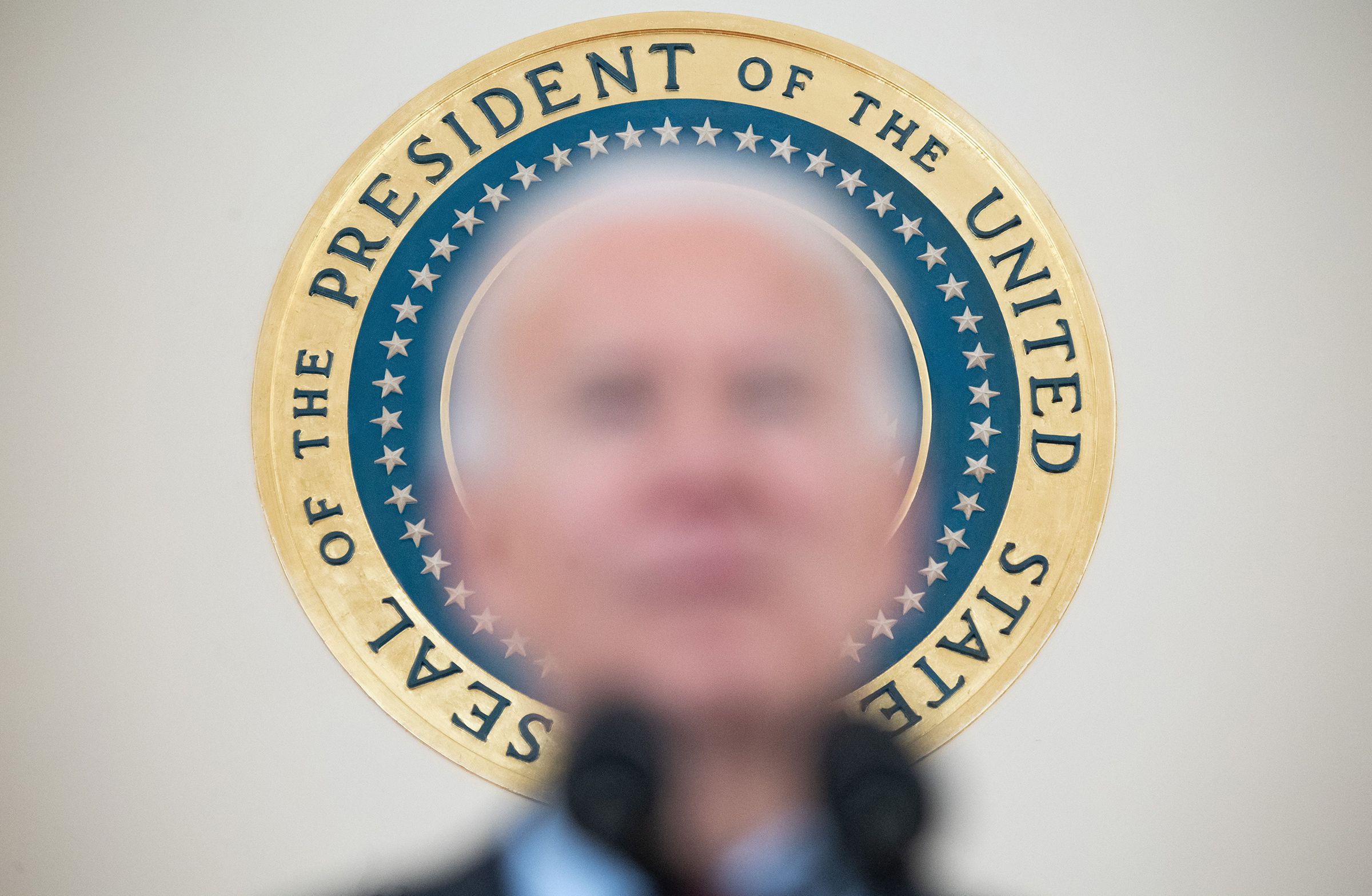 The seal of the President of the United States is seen as President Joe Biden speaks about lives lost to COVID-19 after the death toll passed 500,000, at the White House on Feb. 22, 2021.