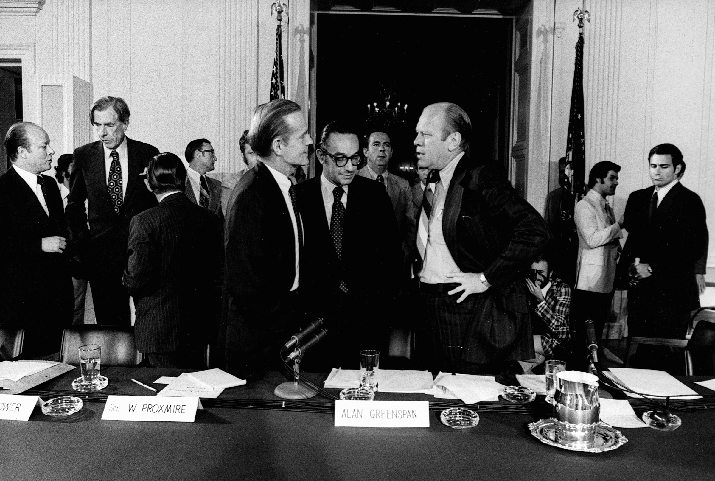 United States President Gerald Ford converses with economists and senators, including Alan Greenspan (center) in a White House conference room on Sept. 5, 1974