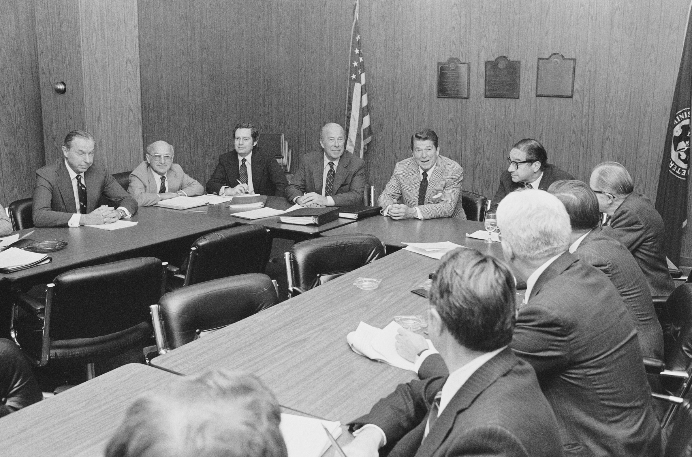 Then President elect Ronald Reagan meets with his top economic advisers at the Los Angeles Federal Building on Nov. 16, 1980, including (from left): Walter Wriston, Milton Friedman, Daryl Trent, George Shultz, Ronald Reagan, and Paul McCracken.