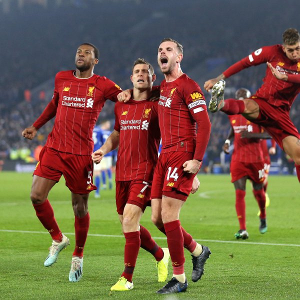 James Milner of Liverpool celebrates with Jordan Henderson and Georginio Wijnaldum during the Premier League match between Leicester City and Liverpool FC at The King Power Stadium in Leicester, United Kingdom on Dec. 26, 2019.