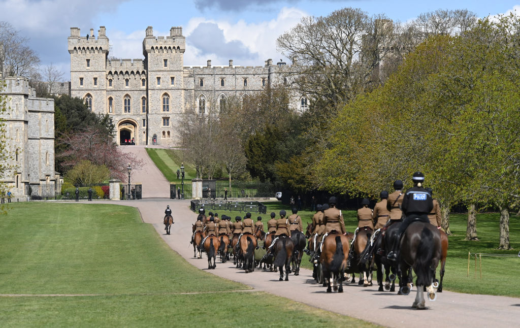 The King's Troop Royal Horse Artillery on horseback make their way up The Long Walk towards Windsor Castle during rehearsal preparations taking place ahead of Prince Philip's funeral, on April 15, 2021 in Windsor, England.