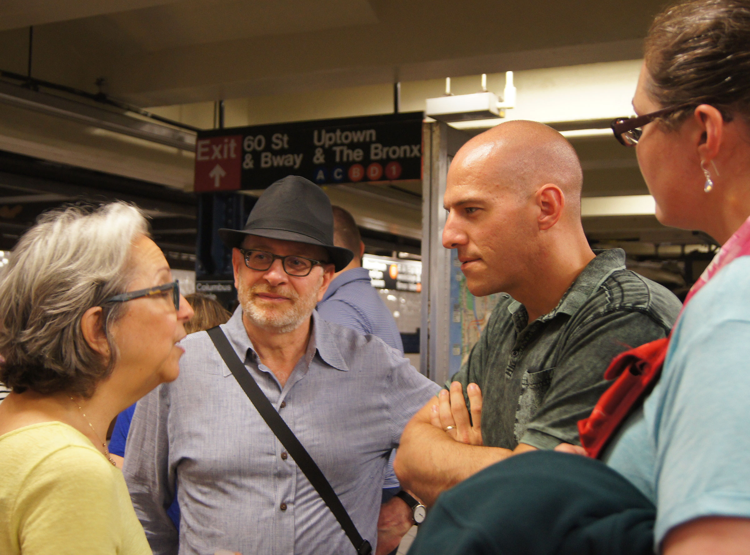 Rabbi Matalon (in hat) with Caleb Follett and other members of the exchange, at a subway stop in New York City.