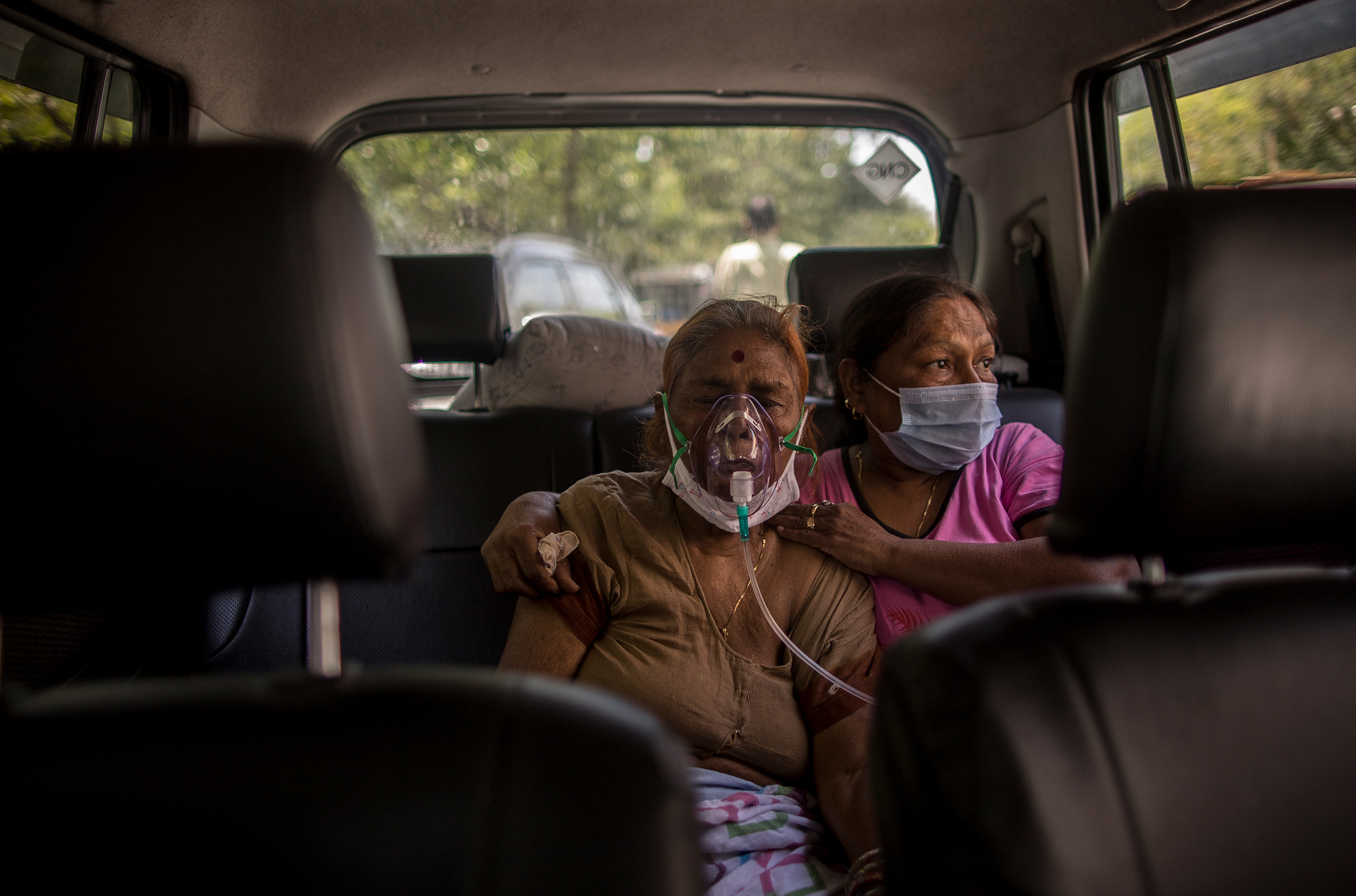 A woman suffering from COVID-19 receives oxygen in New Delhi on April 24, 2021.