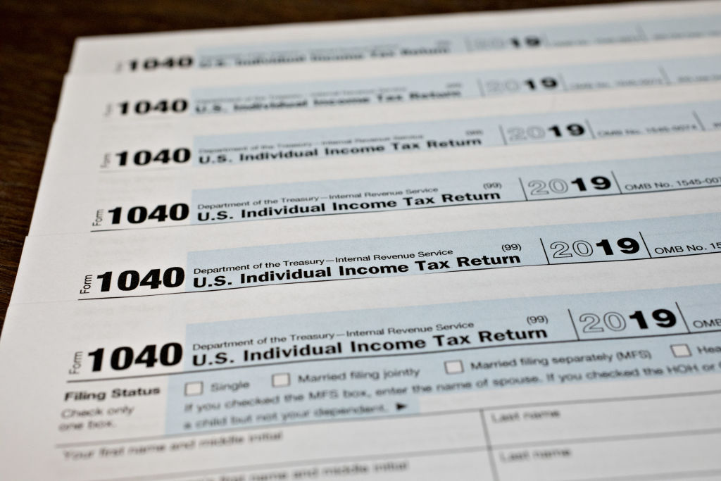 A U.S. Department of the Treasury Internal Revenue Service (IRS) 1040 Individual Income Tax form for the 2019 tax year is arranged for a photograph in Tiskilwa, Illinois, U.S., on Friday, March 20, 2020. Tax forms and payments wont be due to the Internal Revenue Service until July 15 this year, Treasury Secretary Steven Mnuchin said in a tweet, as the government looks for ways to respond to the coronavirus.