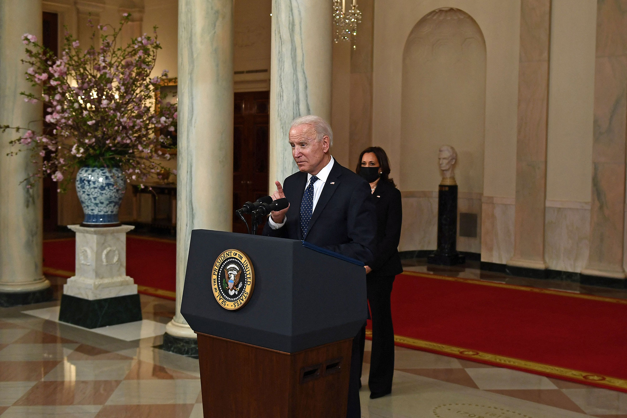 Vice President Kamala Harris listens as President Joe Biden delivers remarks on the guilty verdict against former policeman Derek Chauvin at the White House on April 20, 2021.