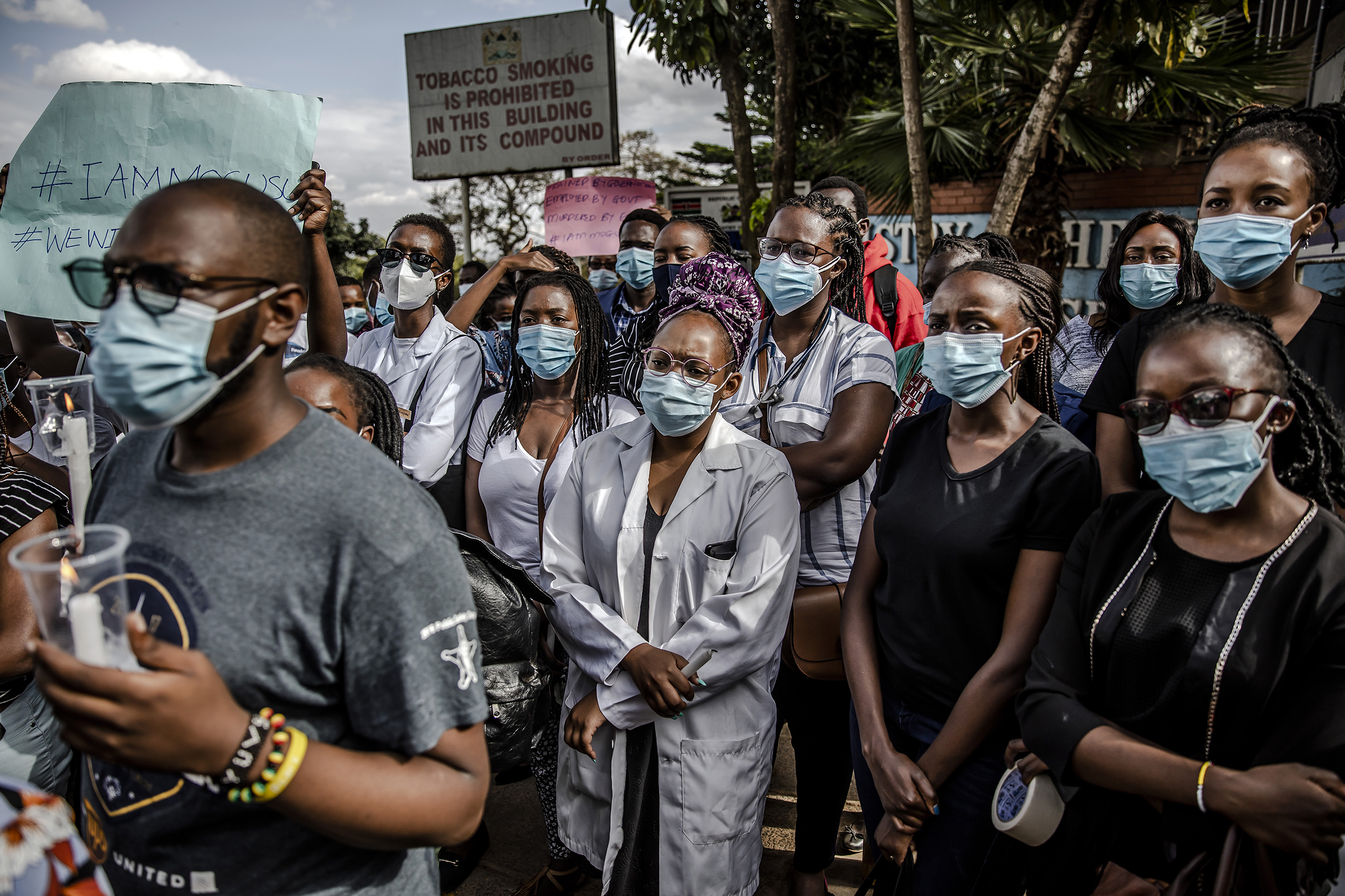 Demonstrators gather during a protest by health care workers, including nurses and clinical officers, against poor working conditions outside the Ministry of Health in Nairobi on Dec. 9, 2020.