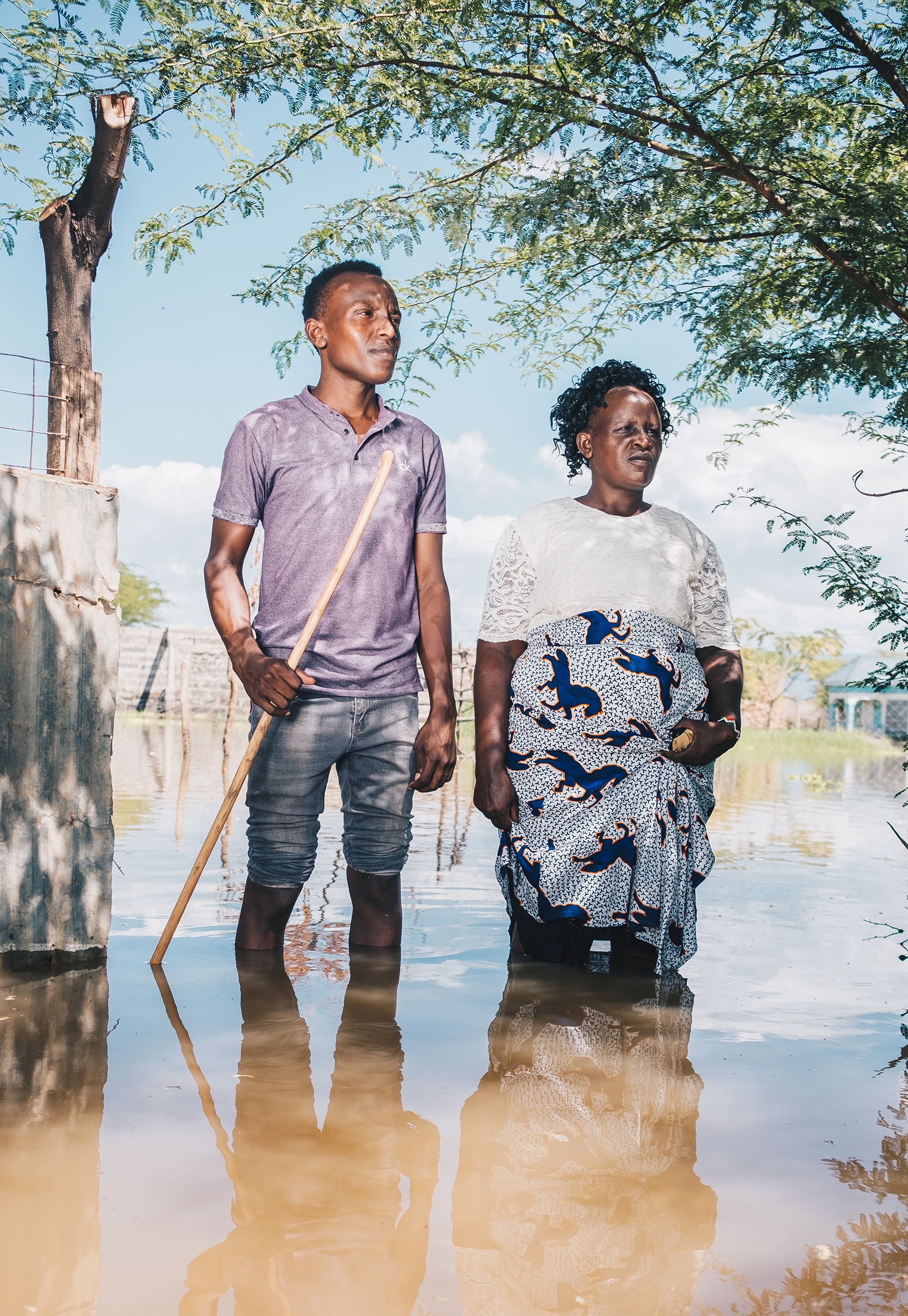 Festus and Veronica Parkolwa stand at the entrance of their former home by Lake Baringo in November.