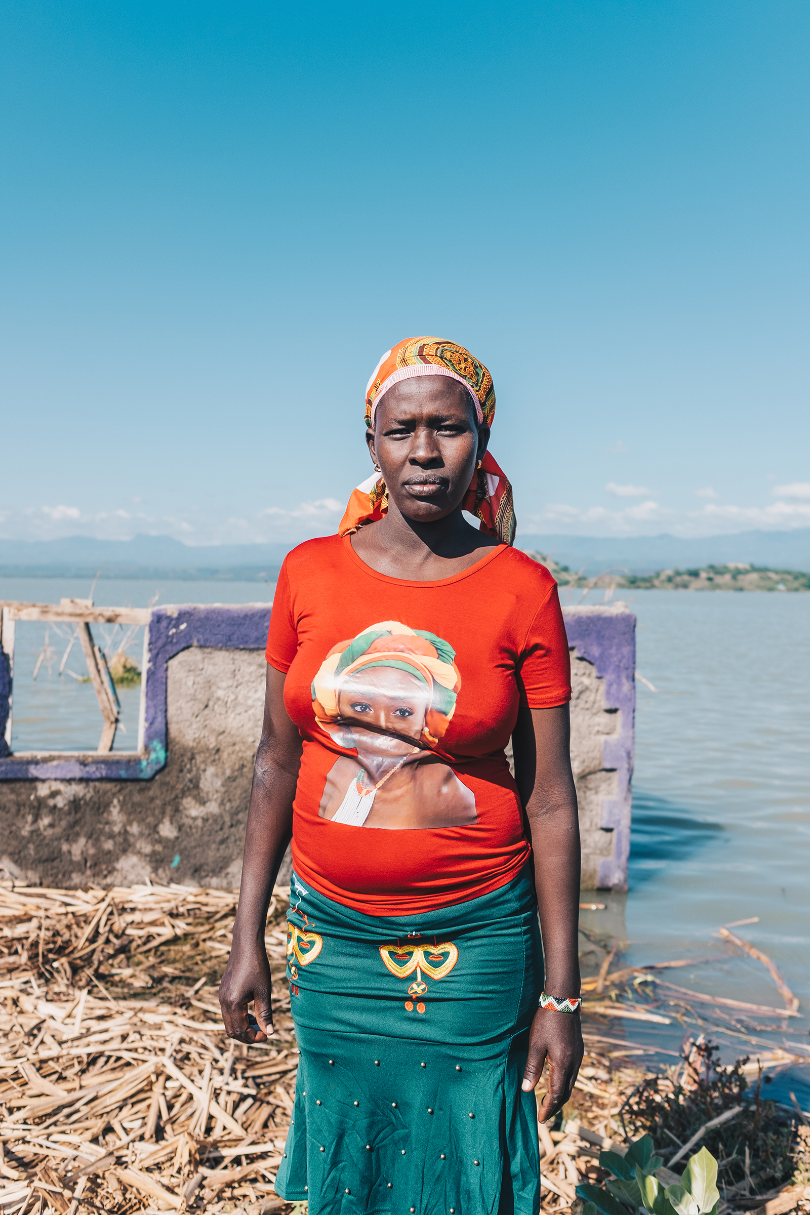 Judy Lewiri stands next to her former home on Ol Kokwe, an island within Lake Baringo. She was forced to move to higher ground and rebuild on borrowed land.