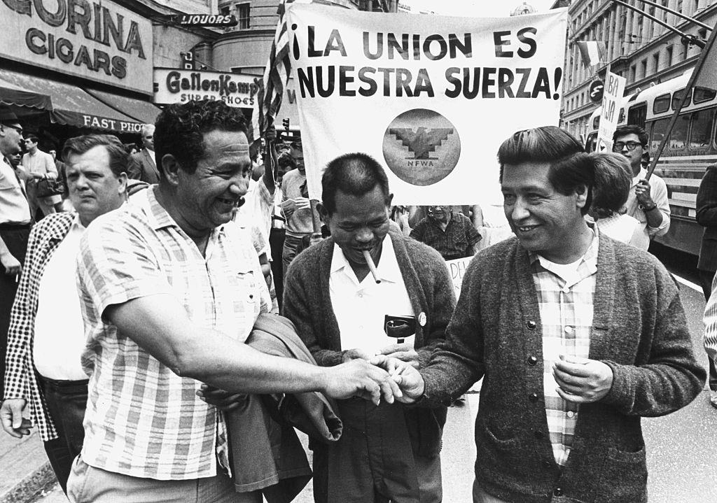 From left to right: United Farm Workers (UFW) officer Julio Hernandez, UFW director Larry Itliong, and Cesar Chavez at the 1966 Huelga Day march in San Francisco.