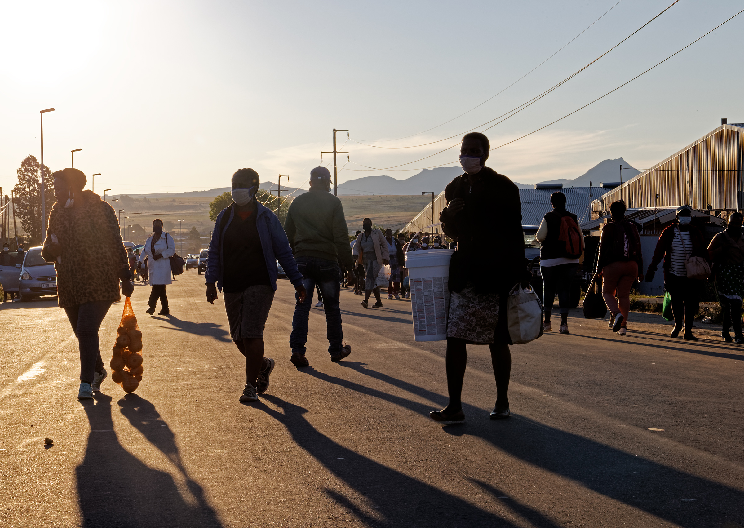 Factory workers head home at the end of the day in Maseru, Lesotho. Many travel by foot and live in nearby villages or surrounding areas as far as seven miles away.