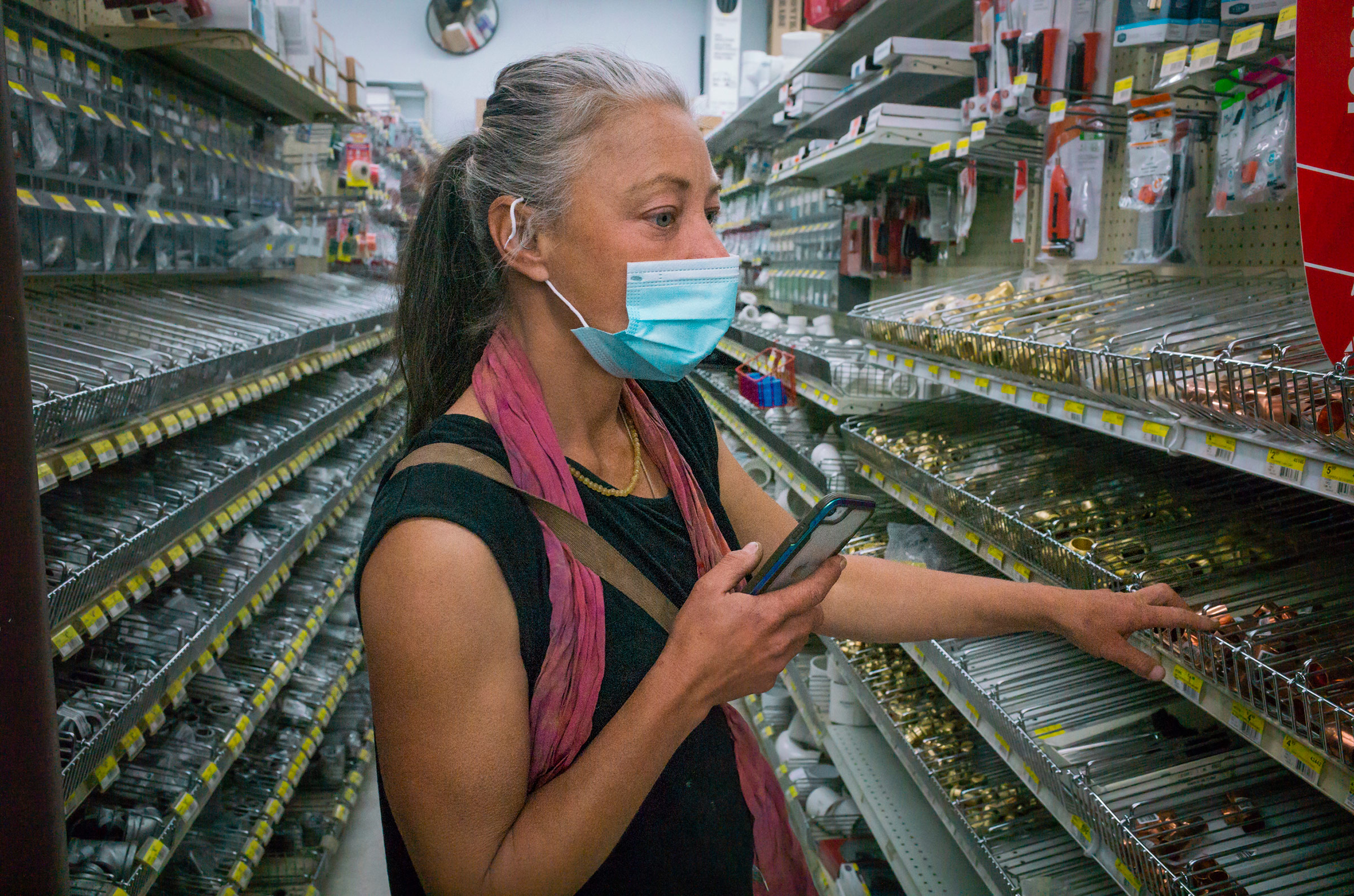 Paula looks for parts for a heater in a local hardware store on March 3.