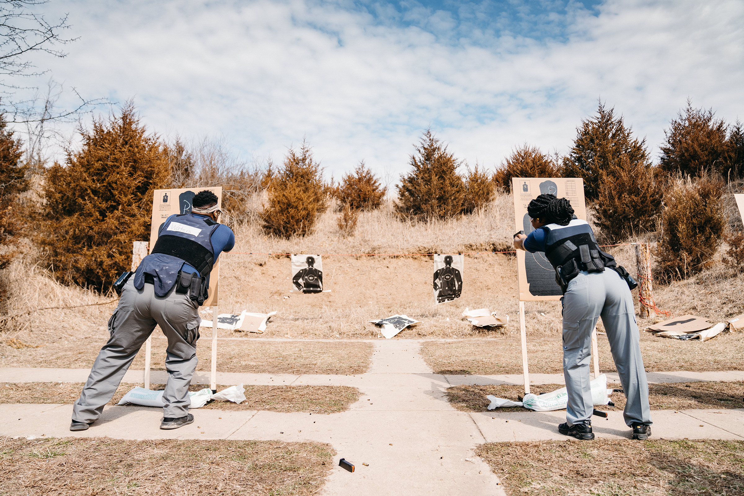 Two students during firearms training at a shooting range in Missouri on March 6