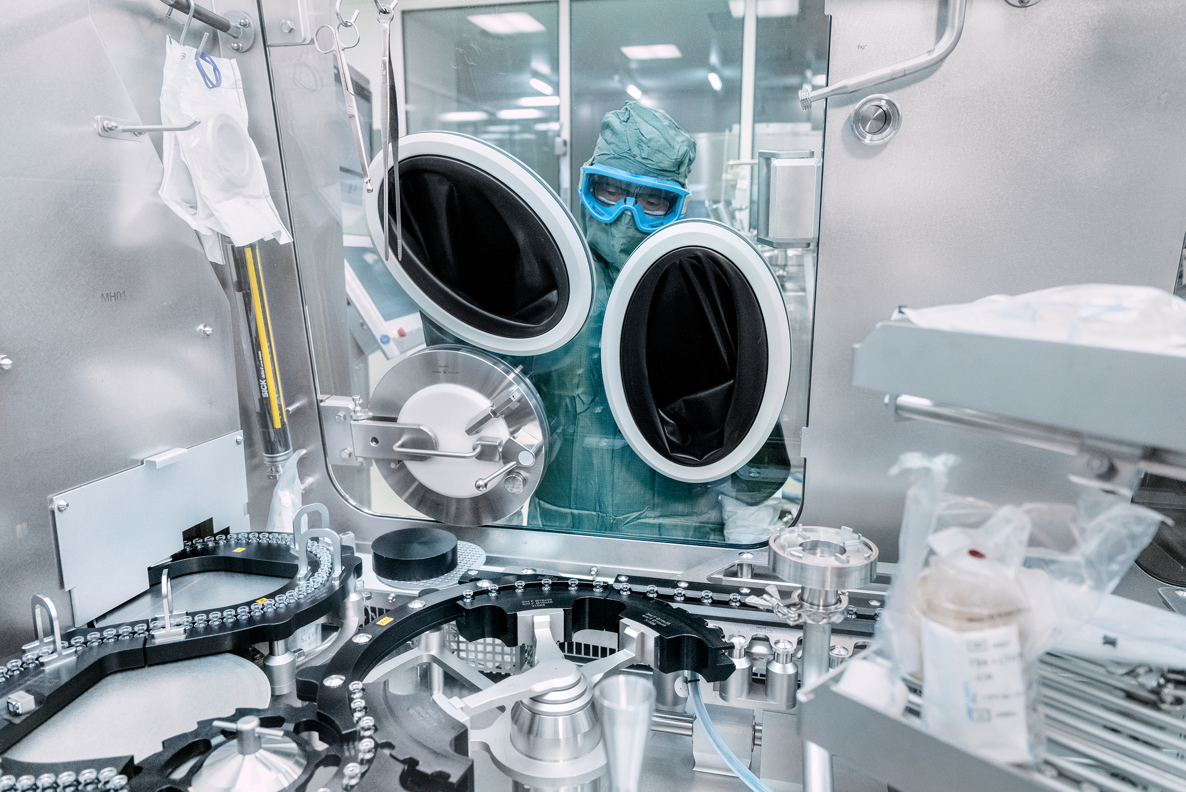 At the fill-and-finish facility operated by Baxter in Halle, 120 miles north of Marburg, technicians monitor the washing and sterilization of the vials before they are filled with vaccine, then stoppered and sealed.