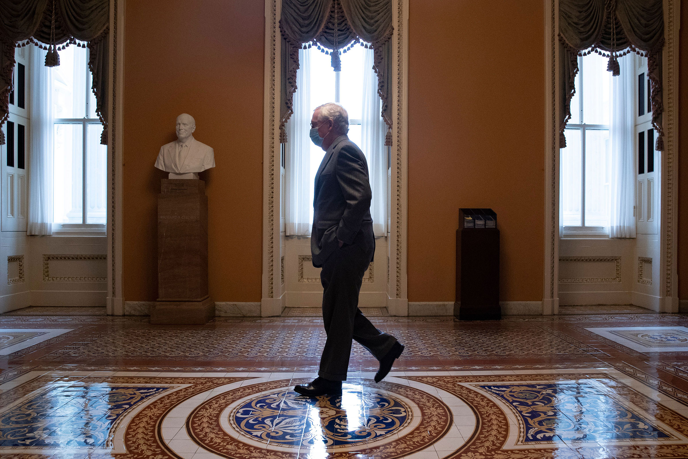 Senate Minority Leader Mitch McConnell walks from the Senate floor to his office on Capitol Hill in Washington, on March 25, 2021.