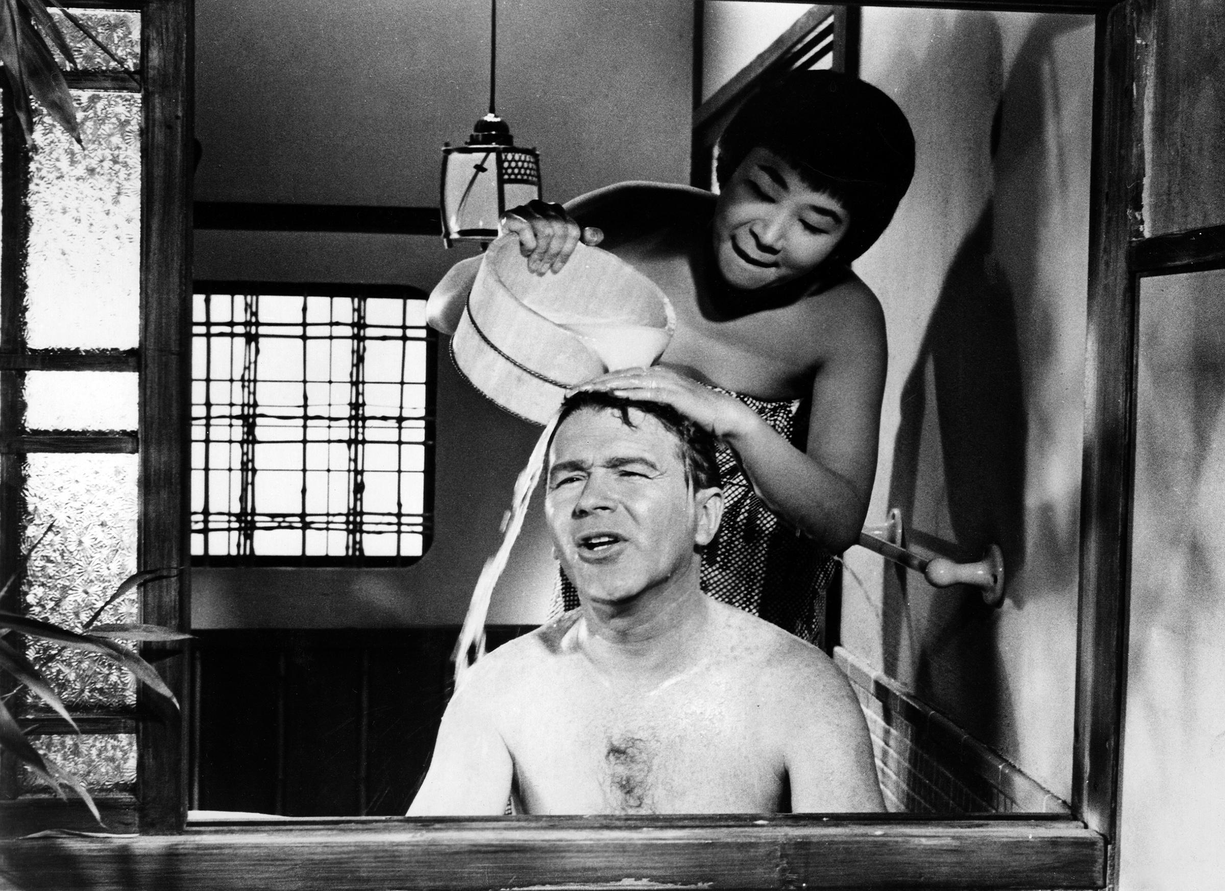 Miyoshi Umeki and Red Buttons in Sayonara, 1957