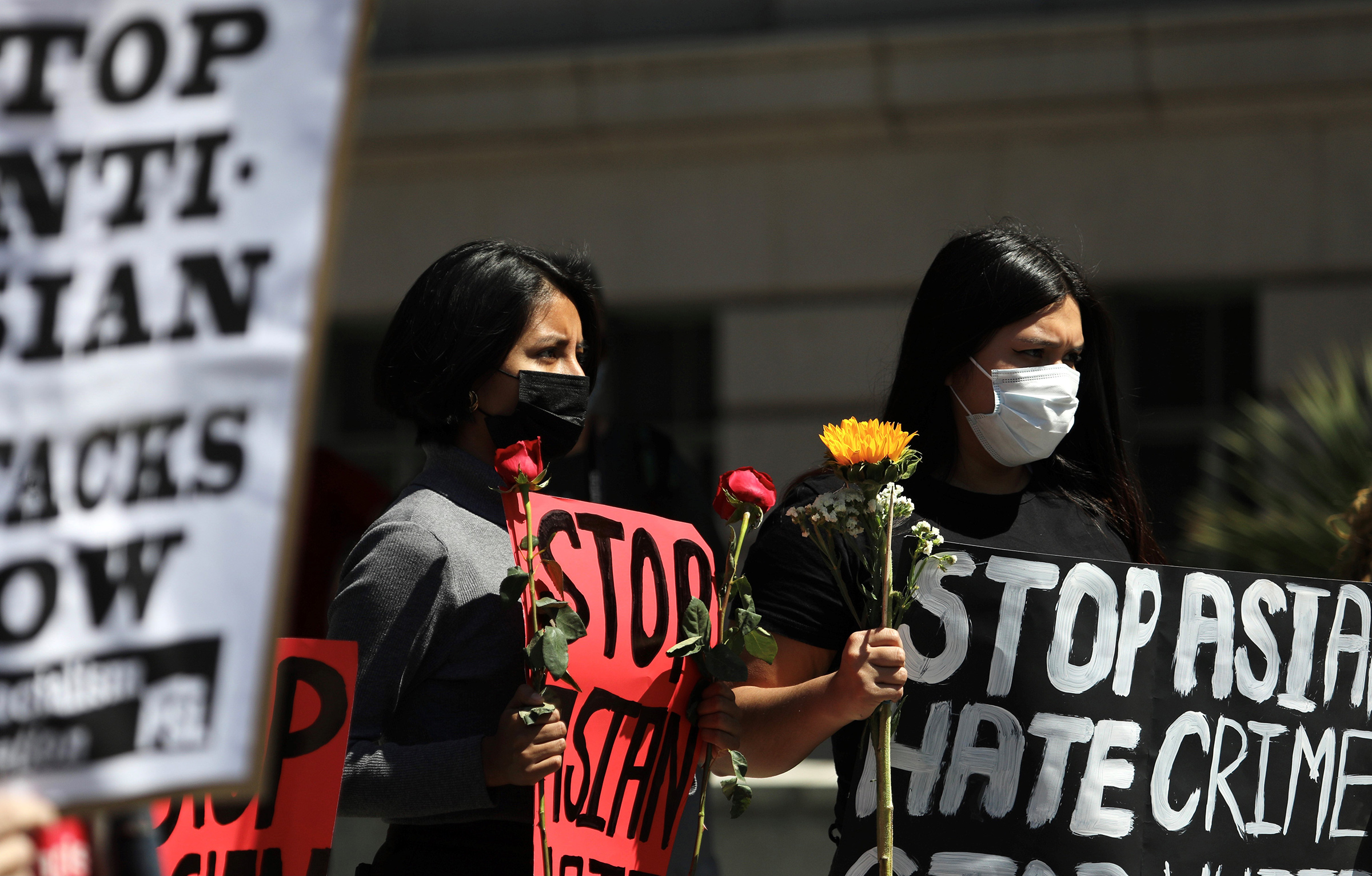 People participate in a Stop Asian Hate rally and march at City Hall in Los Angeles, on March 27, 2021.