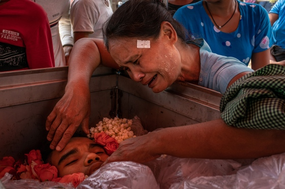 The mother of Aung Zay Min, a 20-year-old who was shot and killed by security forces, mourns over his body at his funeral in Dala township, outside Yangon, Myanmar, on March 27, 2021.