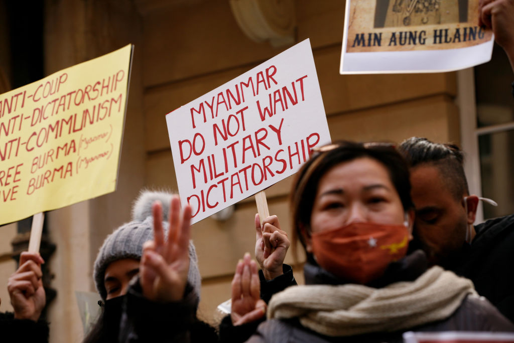 Activists protesting the removal of Myanmar's ambassador to the U.K. demonstrate with three-finger salutes outside the Embassy of Myanmar in London, United Kingdom on April 8, 2021.