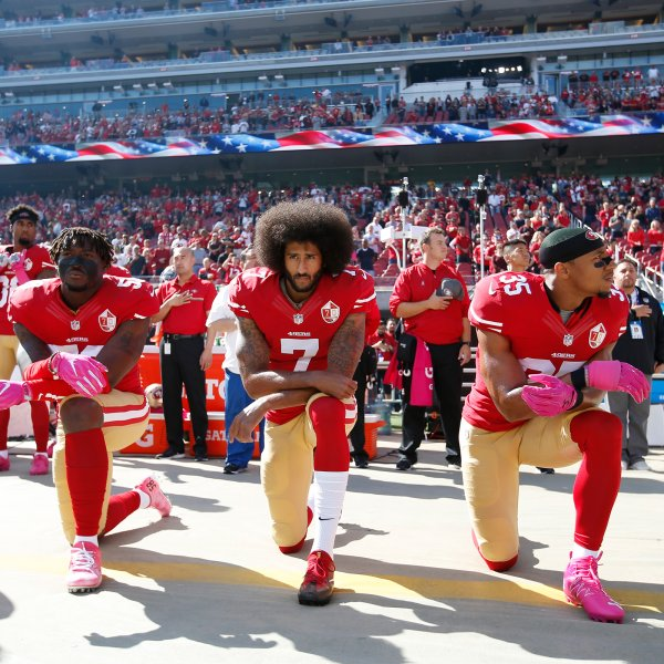 Colin Kaepernick, with teammates Eli Harold and Eric Reid of the San Francisco 49ers, kneel for the anthem prior to the game against the Tampa Bay Buccaneers at Levi Stadium in Santa Clara, Calif. on Oct. 23, 2016.