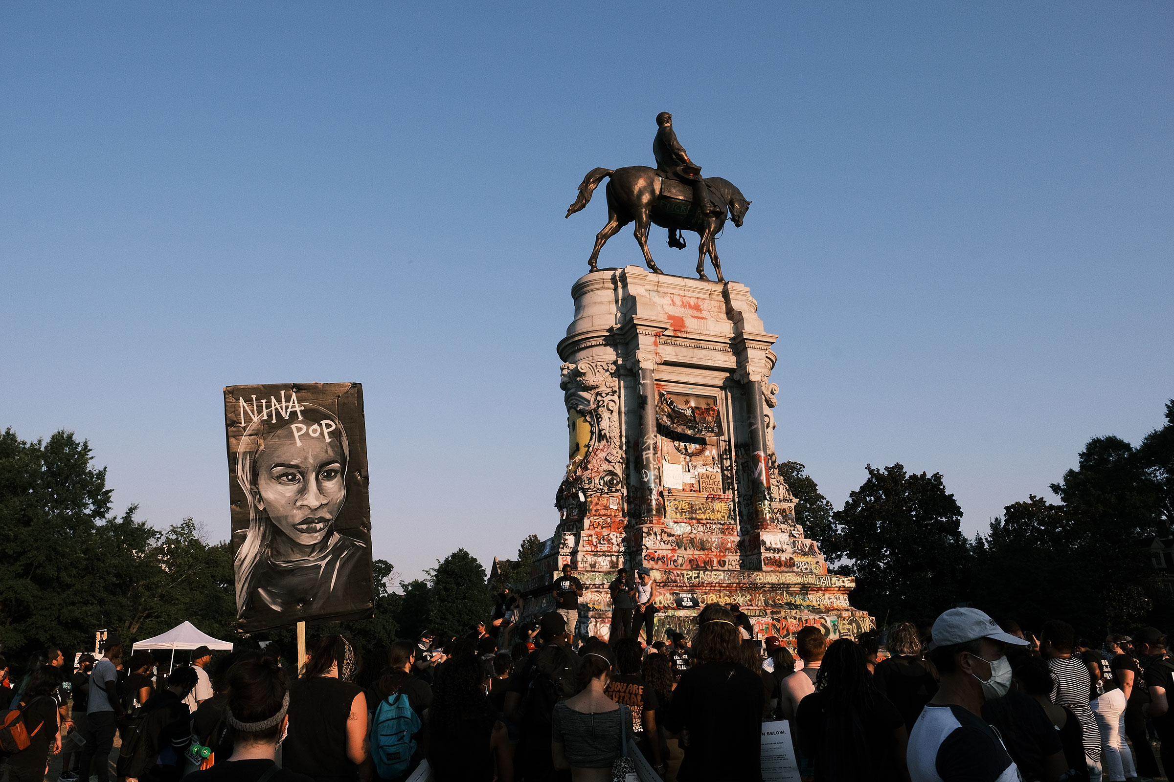 A banner showing the face of Nina Pop at the Lee statue during Black Women Matter  Say Her Name  march on July 3, 2020 in Richmond, Virginia.