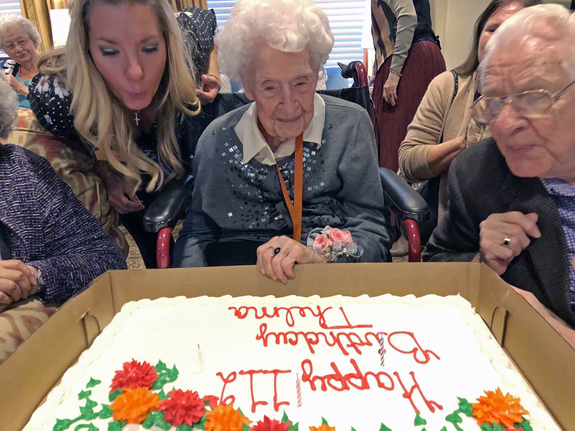Thelma Sutcliffe is shown with a birthday cake in October 2019, in Omaha, Neb. Sutcliffe is now the oldest living American at 114 years old.