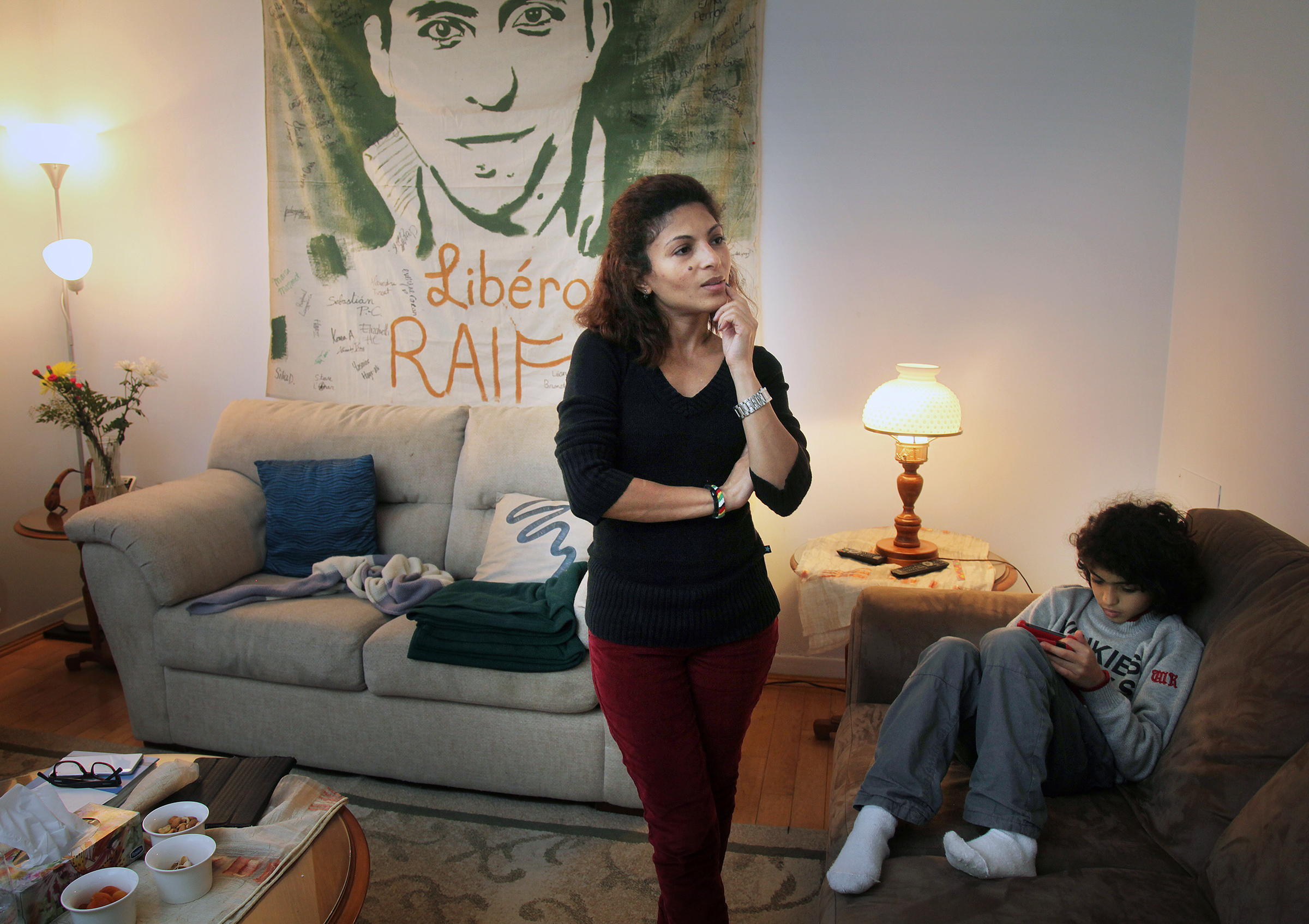 Ensaf Haidar in her home in a small basement apartment in the city of Sherbrooke, Quebec on Jan 19, 2015. She has continued to advocate for her husband's release with the help of Amnesty International. She has been accepted into Canada as a refugee.