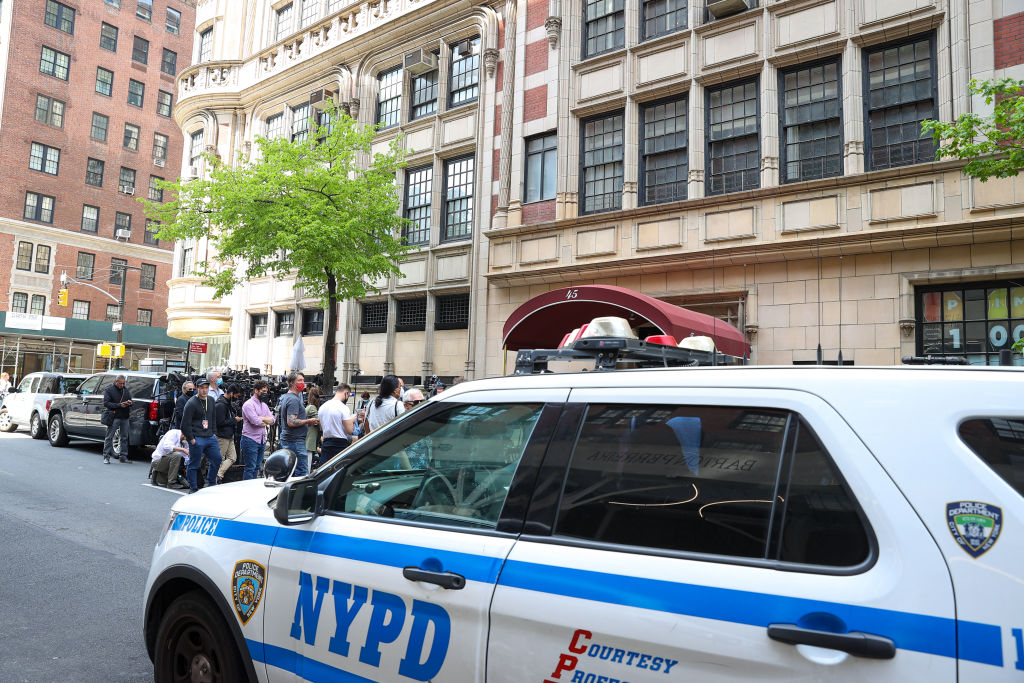 Media gather in front of Rudy Giuliani's Manhattan apartment after federal investigators executed a search warrant on April 28, 2021.