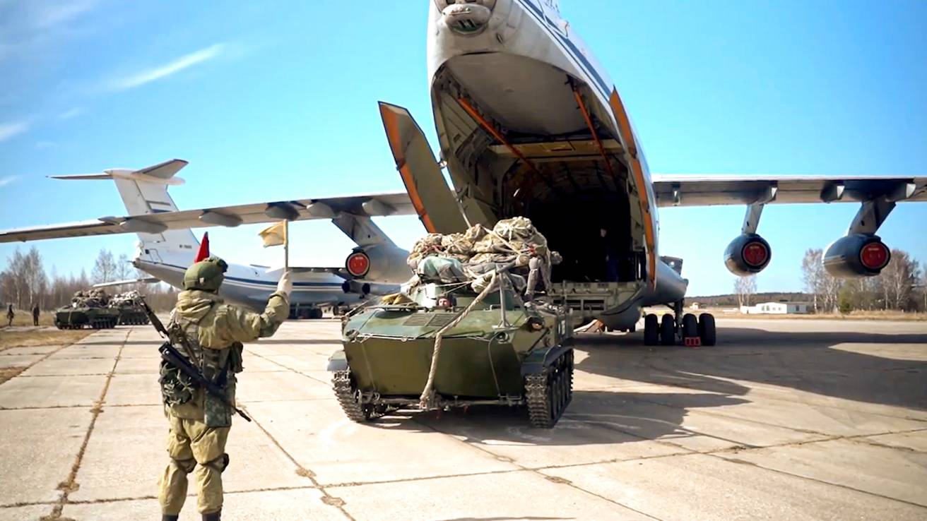 A Russian military vehicle prepares to be loaded into a plane during maneuvers in Crimea, in this image released on April 22