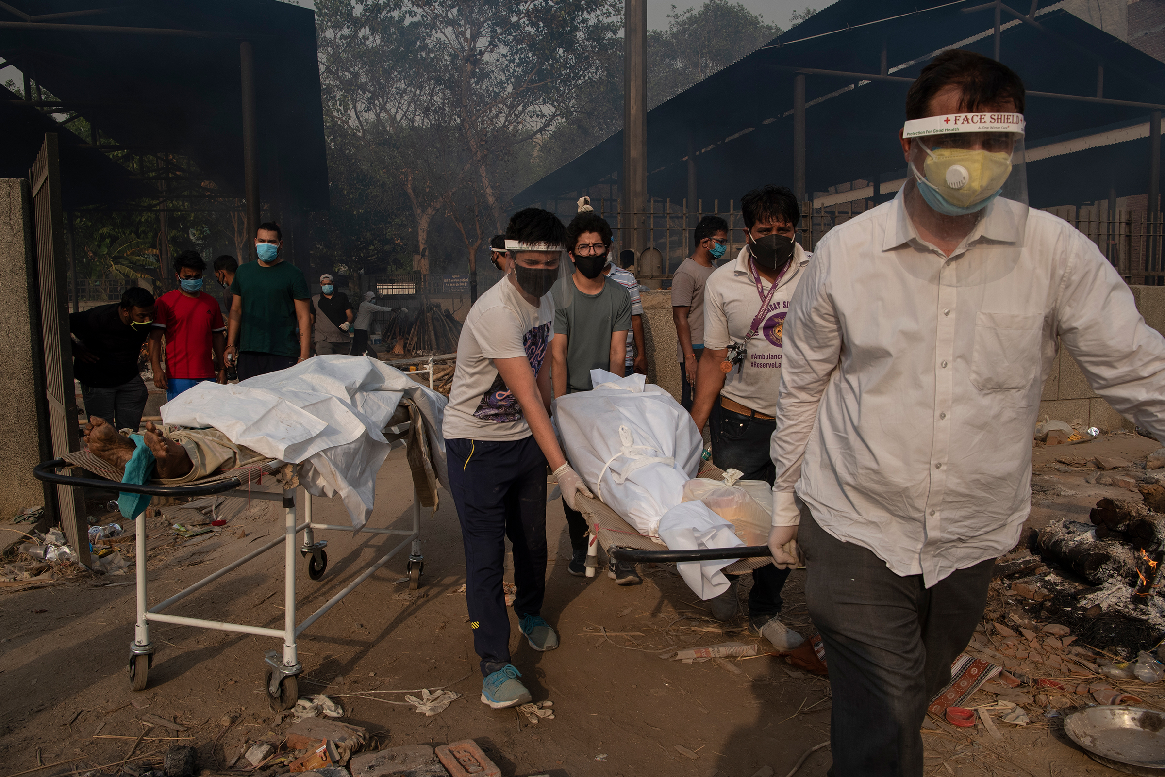 Relatives carry the body of a loved one at a crematorium in New Delhi on April 27, as India endures the world's worst COVID-19 outbreak.