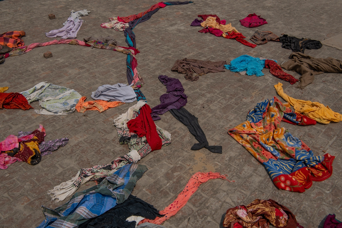 Clothes of the deceased lie on a terrace of a building within the crematorium premises in New Delhi on April 27.