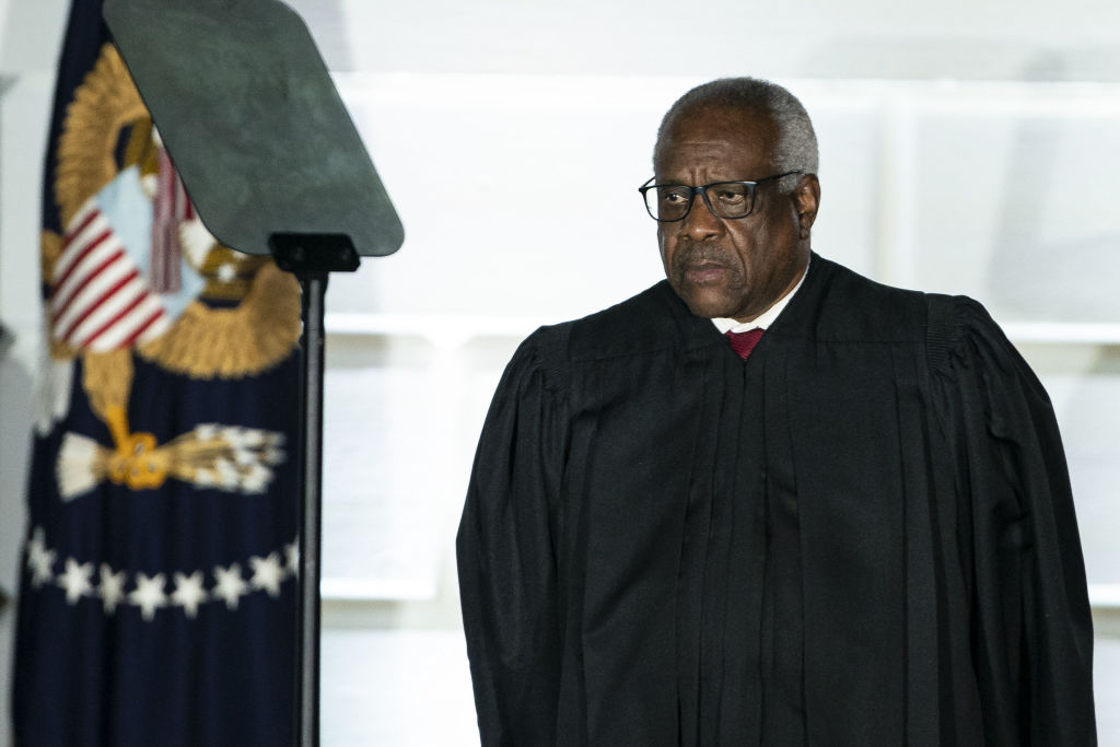 Clarence Thomas, associate justice of the U.S. Supreme Court, listens during a ceremony on the South Lawn of the White House in Washington, D.C., U.S., on Monday, Oct. 26, 2020.
